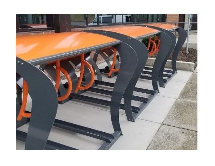 orange outdoor bicycle bike shelter campus office sidewalk